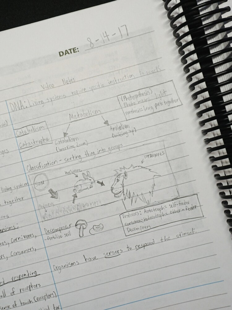 a student notebook for homeschool science opened on a desk