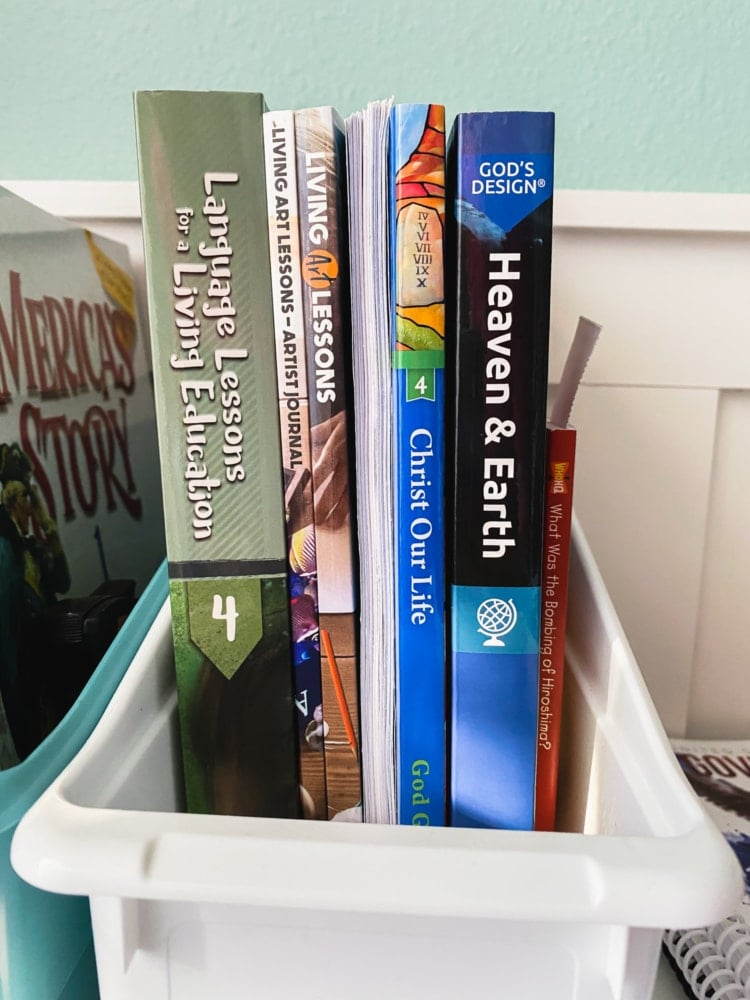 several homeschool curriculum books standing on a desk