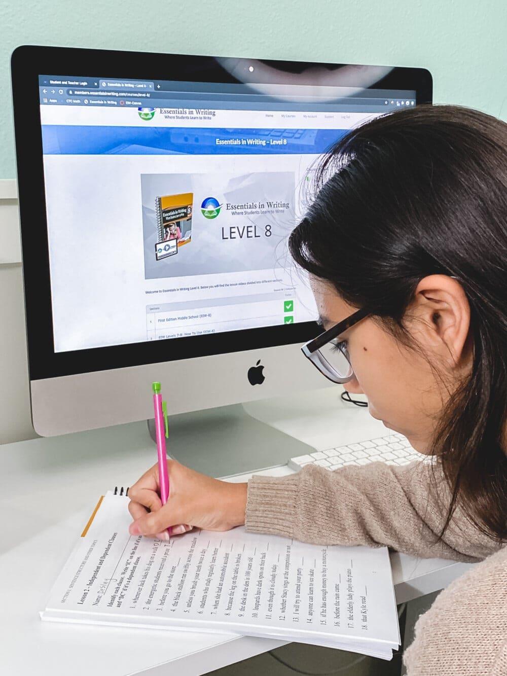 a girl using a computer to do her homeschool english work