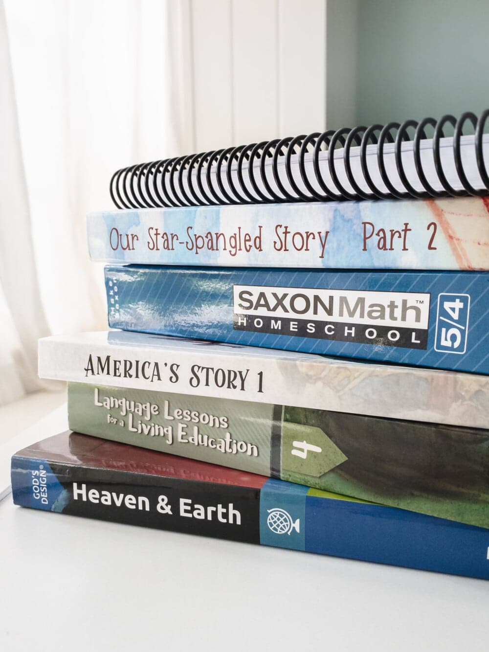 a stack of homeschool curriculum